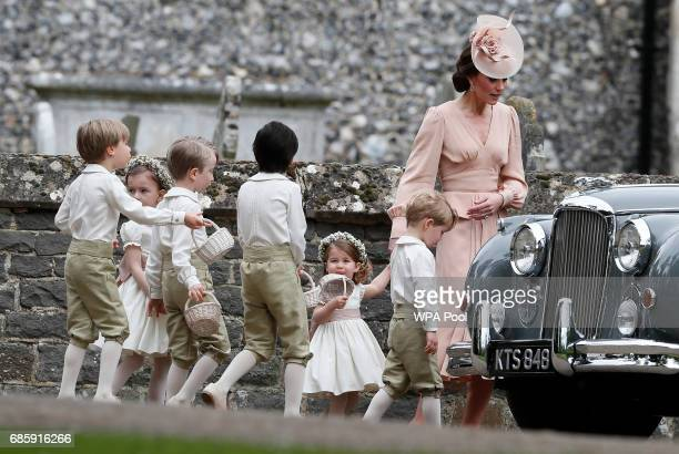 Catherine Duchess of Cambridge right walks with the flower boys and girls including Prince George second right and Princess Charlotte after the...