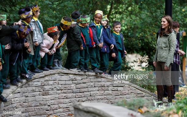 Catherine Duchess of Cambridge says her goodbyes to children during a visit to Sayers Croft Forest School and Wildlife Garden on October 2 2018 in...