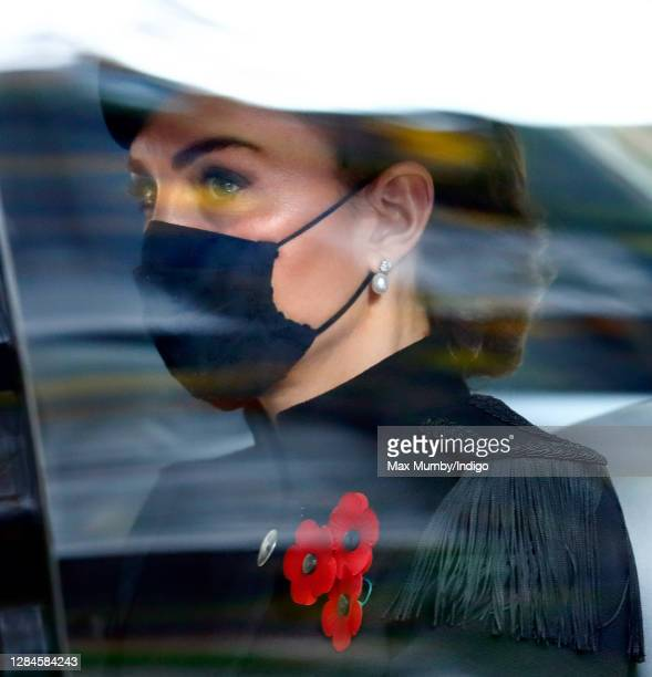 Catherine, Duchess of Cambridge seen wearing a black face mask as she travels in her chauffeur driven car after attending the National Service of...