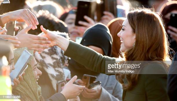 Catherine, Duchess of Cambridge shakes hands with members of the public during a walkabout as she visits a Khidmat Centre on January 15, 2020 in...