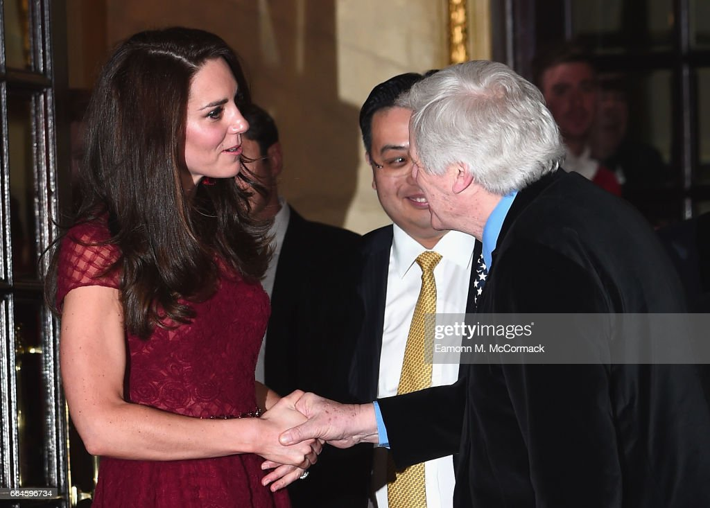 Catherine, Duchess of Cambridge shakes the hand of Lord Michael Grade (R) as she is seen leaving the opening night of '42nd Street' at Theatre Royal on April 4, 2017 in London, England. The opening night is a fundraising event for the East Anglia Children's Hospice (EACH) of which the Duchess of Cambridge is Patron.