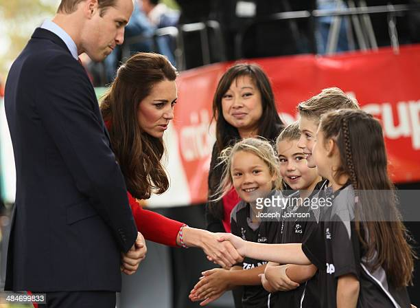 Catherine Duchess of Cambridge shakes young Henry Allott's hand during the countdown to the 2015 ICC Cricket World Cup at Latimer Square on April 14...