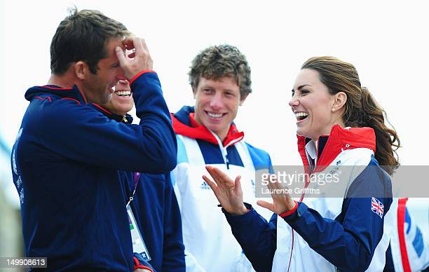 Catherine, Duchess of Cambridge shares a joke with Finn class gold medal winner Ben Ainslie of Great Britain on Day 10 of the London 2012 Olympic...