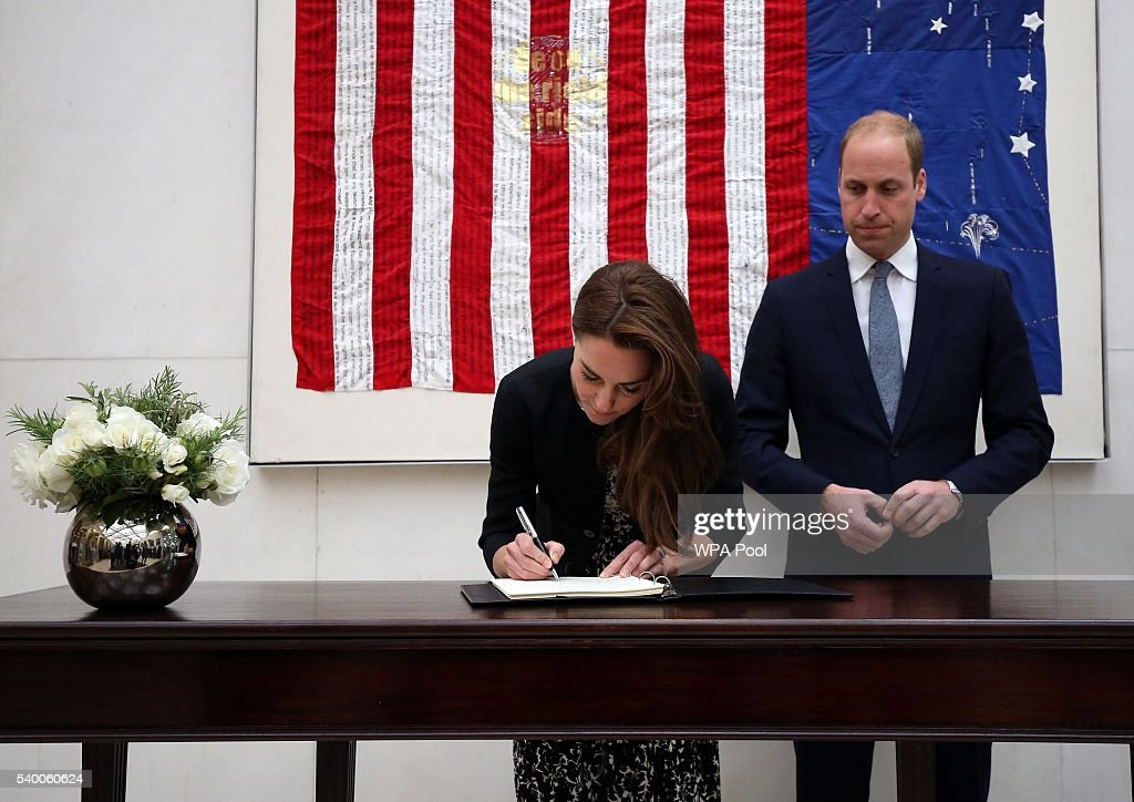 Catherine, Duchess of Cambridge signs a book of condolence for the Orlando mass shooting victims while Prince WIlliam, The Duke of Cambridge looks on at the US Embassy on June 14, 2016 in London, England.