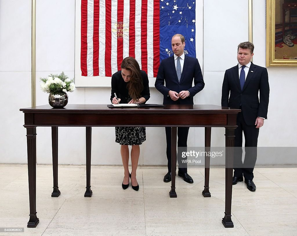 Catherine, Duchess of Cambridge signs a book of condolence for the Orlando mass shooting victims while Prince WIlliam, The Duke of Cambridge (C) and Matthew Barzun (R) , US Ambassador to London look on at the US Embassy on June 14, 2016 in London, England.