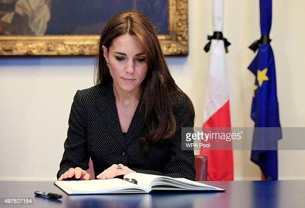 Catherine, Duchess of Cambridge, signs the book of condolences after the terror attacks which killed at least 129 people in Paris, at the French...