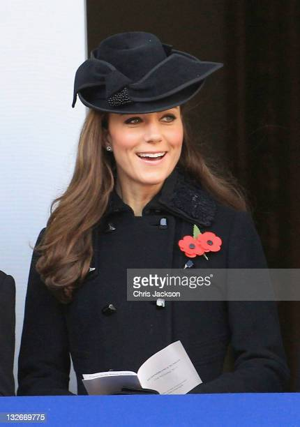 Catherine Duchess of Cambridge sings during the Remembrance Day Ceremony at the Cenotaph on November 13 2011 in London United Kingdom Politicians and...