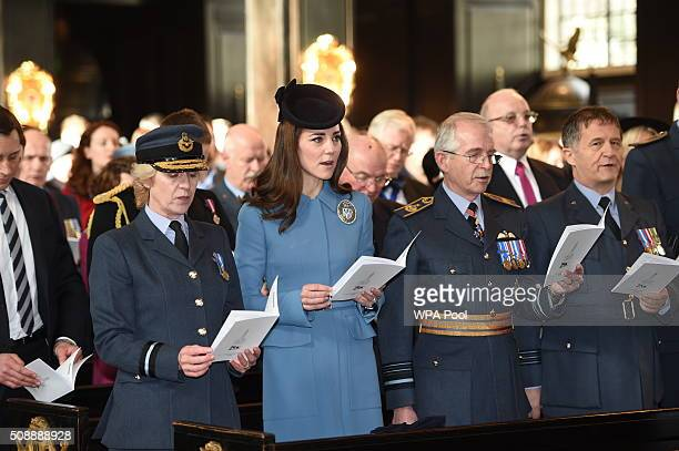 Catherine Duchess of Cambridge sings during the service to mark the 75th Anniversary of the RAF Air Cadets at St Clement Danes Church on February 7...