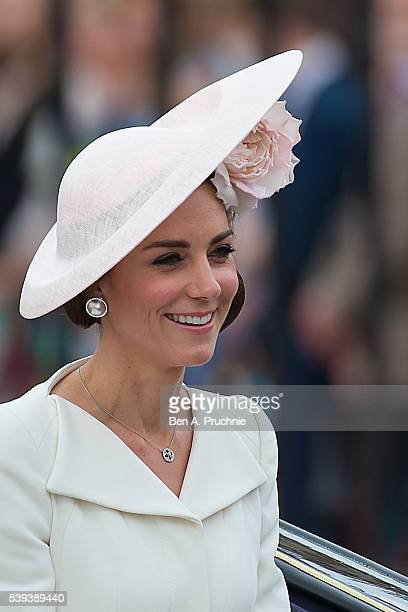 Catherine, Duchess of Cambridge sits in a carriage during the Trooping the Colour, this year marking the Queen's 90th birthday at The Mall on June...