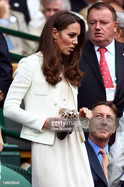 Catherine Duchess of Cambridge sits in the Royal Box during the Gentlemen's Singles final match between Roger Federer of Switzerland and Andy Murray...
