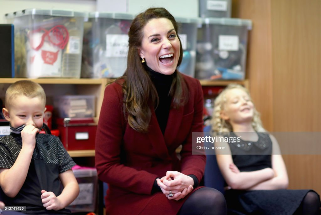 Catherine, Duchess of Cambridge sits next to 7 year old Alfie Thomas and 9 year old Emily Davis as she visits Caerphilly Family Intervention Team (FIT) to learn about their work with children with emotional and behavioural difficulties, problems with family relationships and those who have or who are likely to self-harm on February 22, 2017 in Caerphilly, United Kingdom.