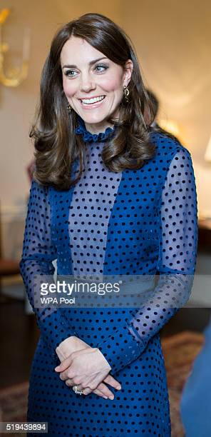 Catherine, Duchess of Cambridge smiles as she attends a reception ahead of their tour of India and Bhutan at Kensington Palace on April 6, 2016 in...