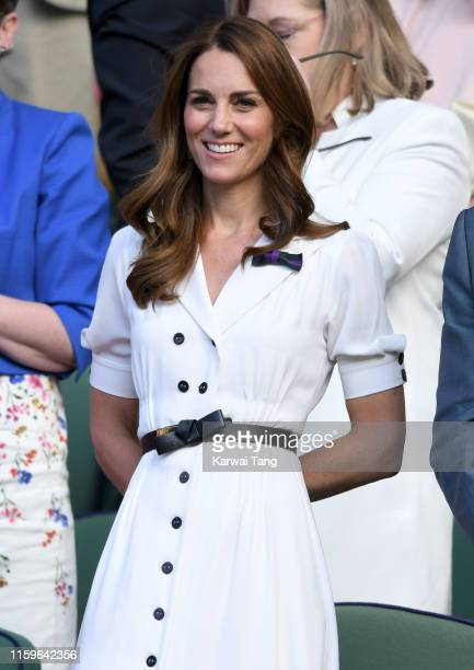 Catherine, Duchess of Cambridge smiles as she attends day 2 of the Wimbledon Tennis Championships at the All England Lawn Tennis and Croquet Club on...