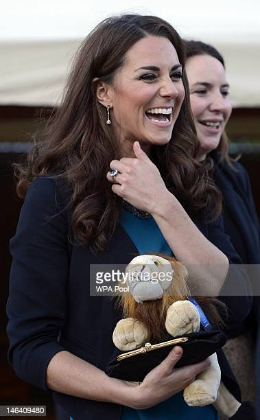 Catherine Duchess of Cambridge smiles as she hosts children and young people from the Art Room at a performance of 'The Lion The Witch and The...