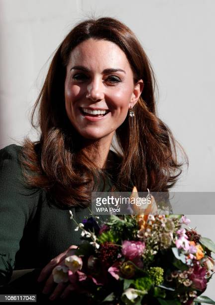 Catherine Duchess of Cambridge smiles as she leaves after visiting a new national support line at the charity Family Action on January 22 2019 in...