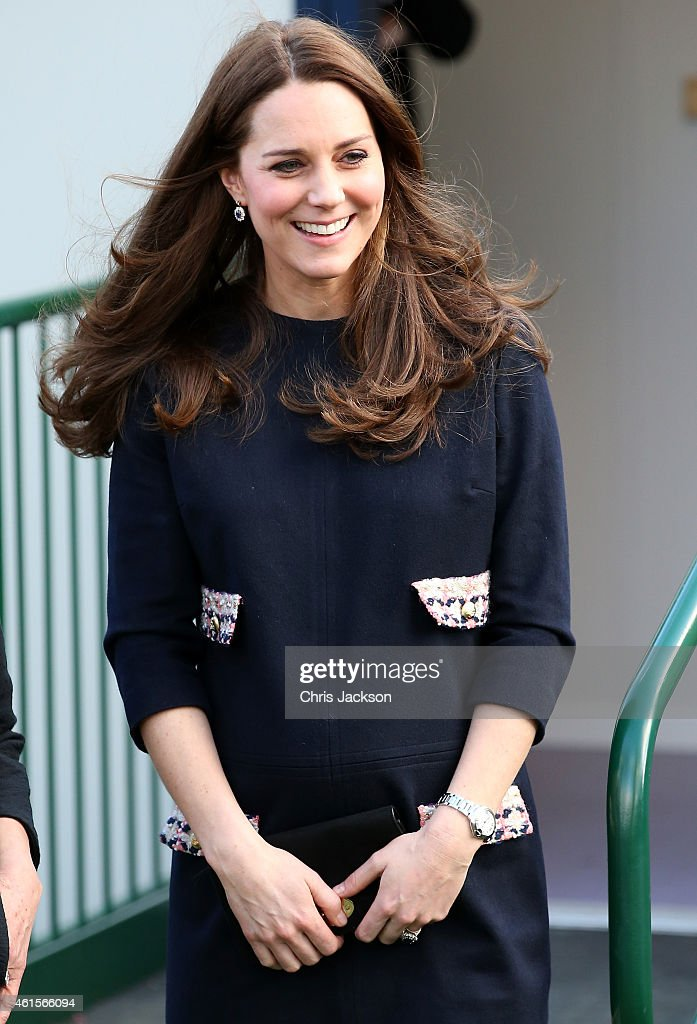 Catherine, Duchess of Cambridge smiles as she leaves Barlby Primary School on January 15, 2015 in London, England. The Duchess of Cambridge is visiting the Clore Art Room at Barlby School to support the charity 'The Art Room' of which she is patron.