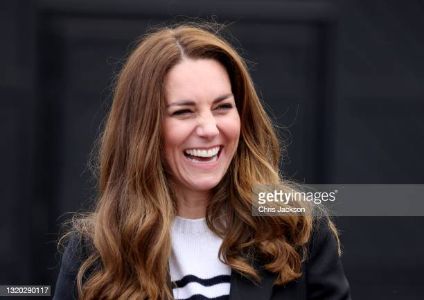 Catherine, Duchess of Cambridge smiles as she meets local fishermen and their families to hear about the work of fishing communities in the village...
