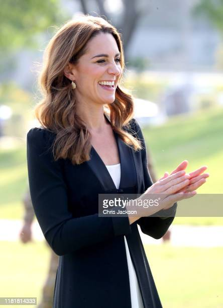 Catherine, Duchess of Cambridge smiles as she visits an Army Canine Centre with Prince William, Duke of Cambridge, where the UK provides support to a...