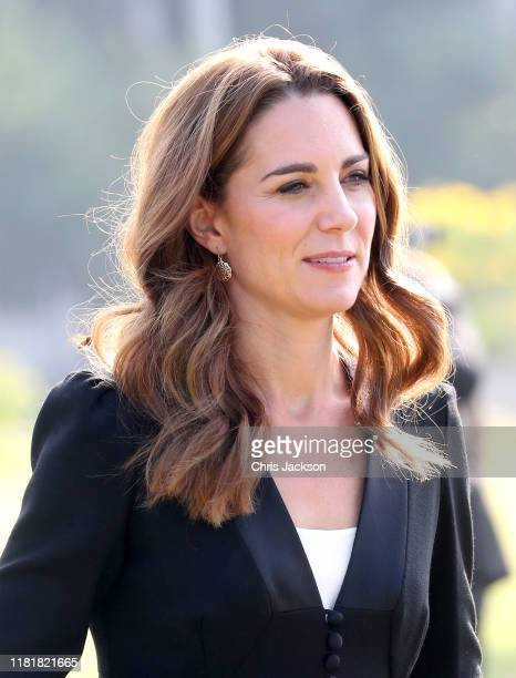 Catherine Duchess of Cambridge smiles as she visits an Army Canine Centre with Prince William Duke of Cambridge where the UK provides support to a...