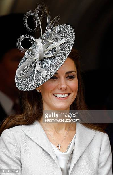 Catherine, Duchess of Cambridge, smiles as she watches the procession at the Order of the Garter Service at St George's Chapel in Windsor Castle on...