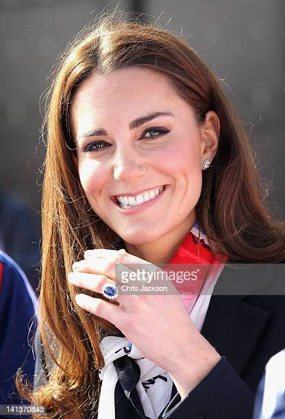 Catherine Duchess of Cambridge smiles as she wears the Team GB Official Supporter's Scarf for London 2012 before meeting the GB HockeyTeam at the...
