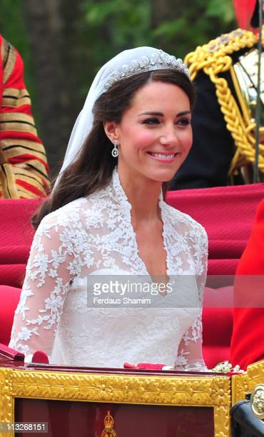 Catherine, Duchess of Cambridge smiles at the cheering crowds as she departs Westminster Abbey after her marriage to Prince William on April 29, 2011...