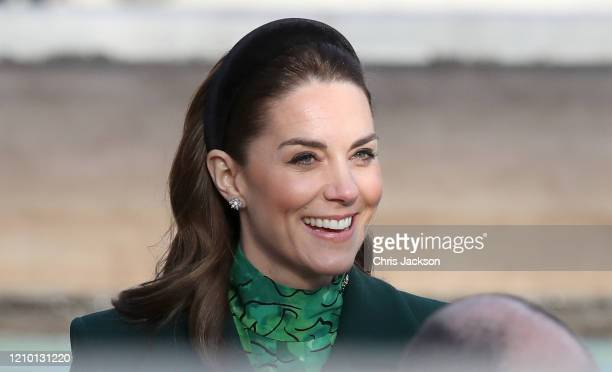 Catherine, Duchess of Cambridge smiles at wellwishers ahead of attending a commemorative wreath laying ceremony with Prince William, Duke of...
