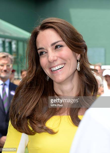 Catherine Duchess of Cambridge smiles during a visit to the Wimbledon Lawn Tennis Championships at the All England Lawn Tennis and Croquet Club on...