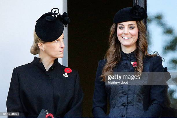 Catherine Duchess of Cambridge smiles from a balcony accompanied by Sophie Countess of Wessex as they watch a wreath laying ceremony at the Cenotaph...
