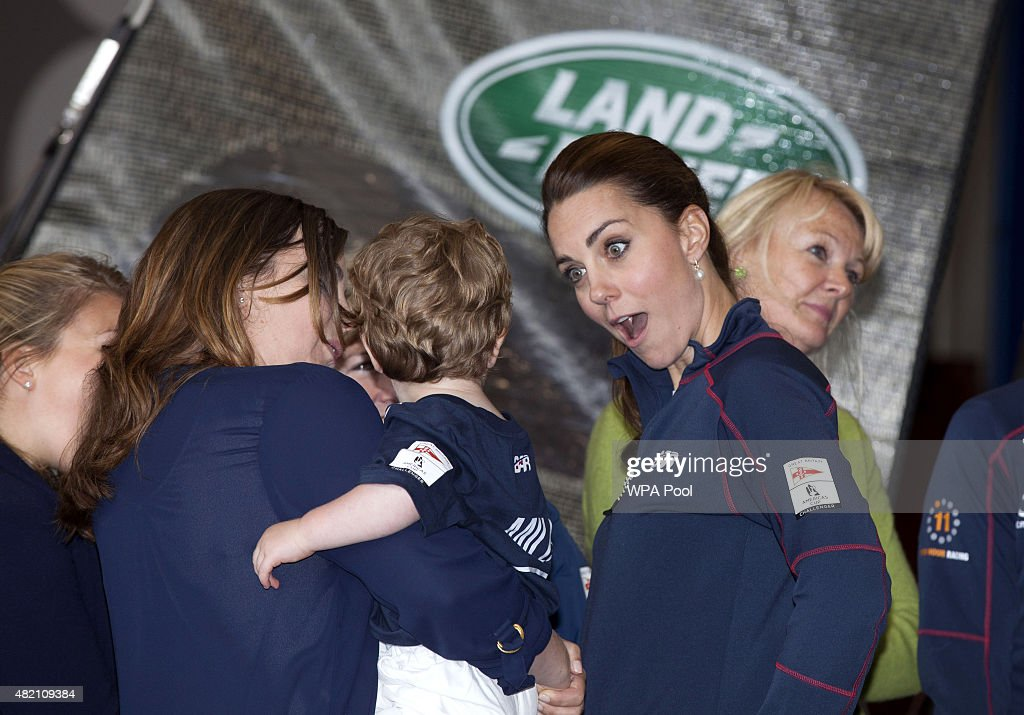 Catherine, Duchess of Cambridge speaks to a young child during a visit to the headquarters of Britain's Land Rover-backed BAR team during the America's Cup World Series event on July 26, 2015 in Portsmouth, England.
