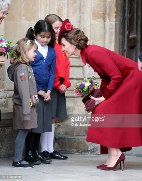 Catherine, Duchess of Cambridge speaks to a young wellwisher as she departs the Commonwealth Day Service 2020 at Westminster Abbey on March 09, 2020...