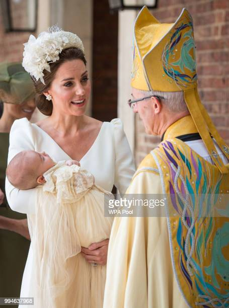 Catherine Duchess of Cambridge speaks to Archbishop of Canterbury Justin Welby as she arrives carrying Prince Louis for his christening service at...