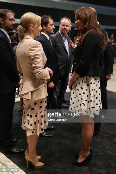 Catherine Duchess of Cambridge speaks to British author JK Rowling during the Inauguration Of Warner Bros Studios Leavesden on April 26 2013 in...