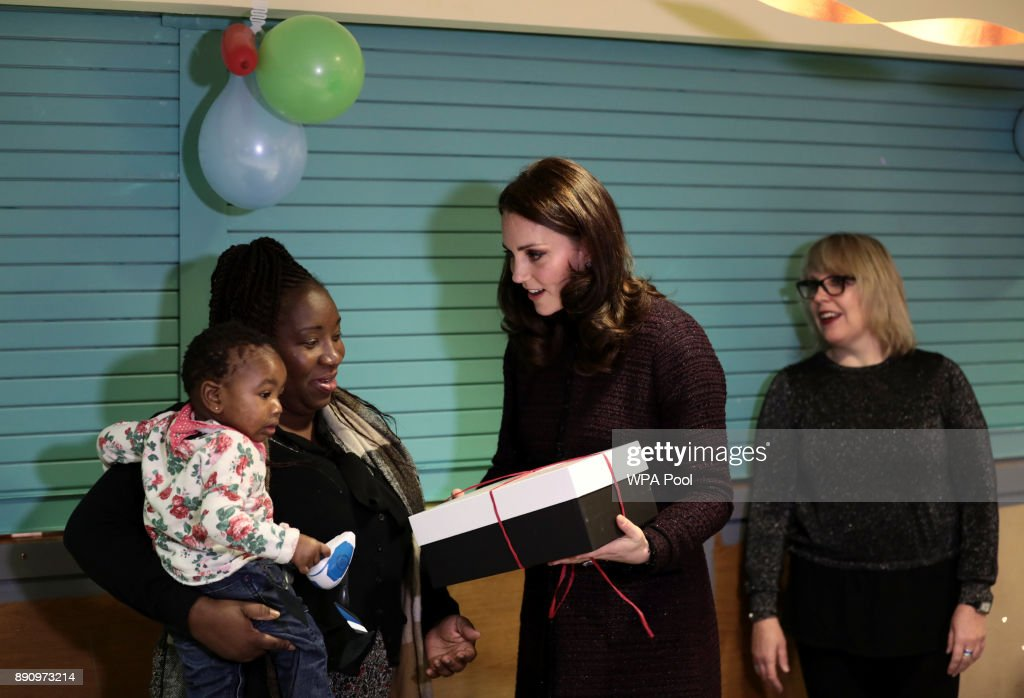 Catherine, Duchess of Cambridge speaks to children, during a visit to the Rugby Portobello Trust's Christmas party which included children affected by the Grenfell Tower fire, at its community centre in North Kensington on December 12, 2017 in London United Kingdom.