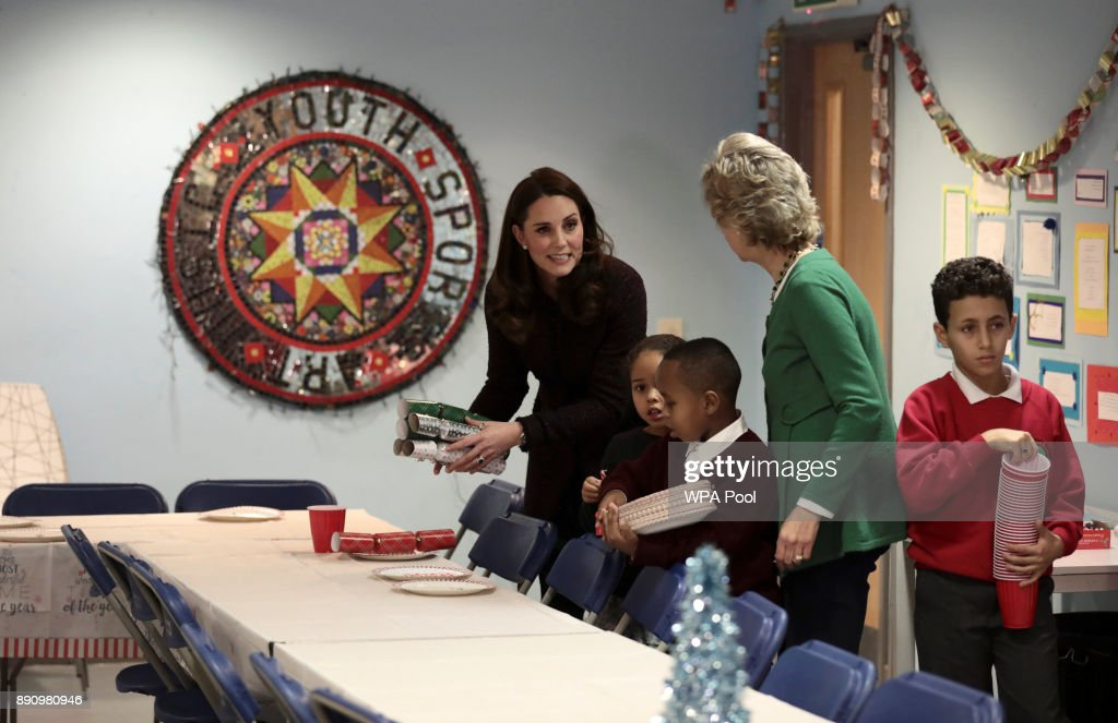 Catherine, Duchess of Cambridge speaks to children during a visit to the Rugby Portobello Trust's Christmas party, which included children affected by the Grenfell Tower fire, at its community centre in North Kensington on December 12, 2017 in London United Kingdom.