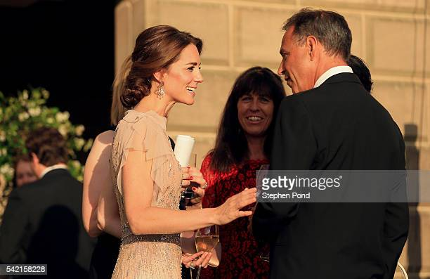 Catherine Duchess of Cambridge speaks to EACH Ambassador Anthony Horowitz as she attends a gala dinner in support of East Anglia's Children's...