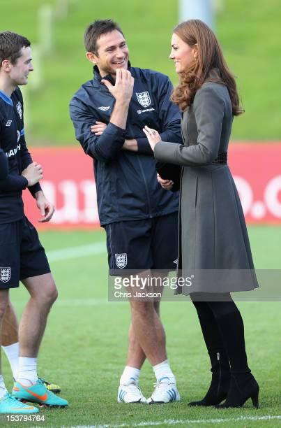 Catherine Duchess of Cambridge speaks to Frank Lampard of England during the official launch of The Football Association's National Football Centre...
