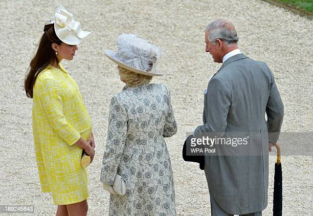 Catherine Duchess of Cambridge speaks to her motherinlaw Camilla Duchess of Cornwall as Prince Charles Prince of Wales looks on as they attend a...