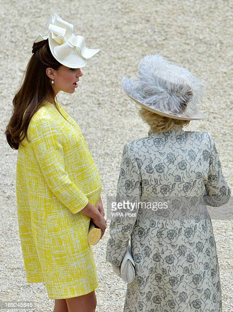 Catherine Duchess of Cambridge speaks to her motherinlaw Camilla Duchess of Cornwall as they attend a Garden Party in the grounds of Buckingham...