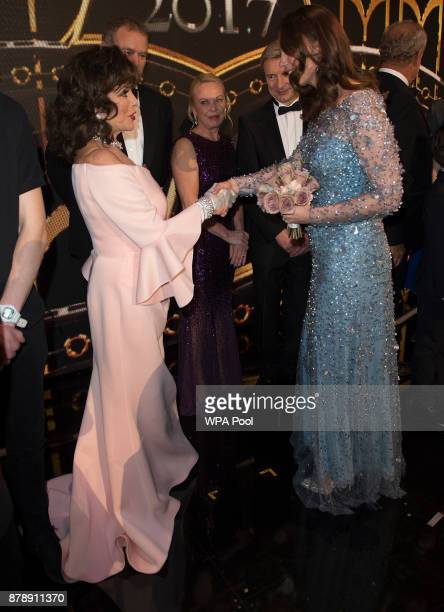 Catherine Duchess of Cambridge speaks to Joan Collins on stage as they attend the Royal Variety Performance at the Palladium Theatre on November...