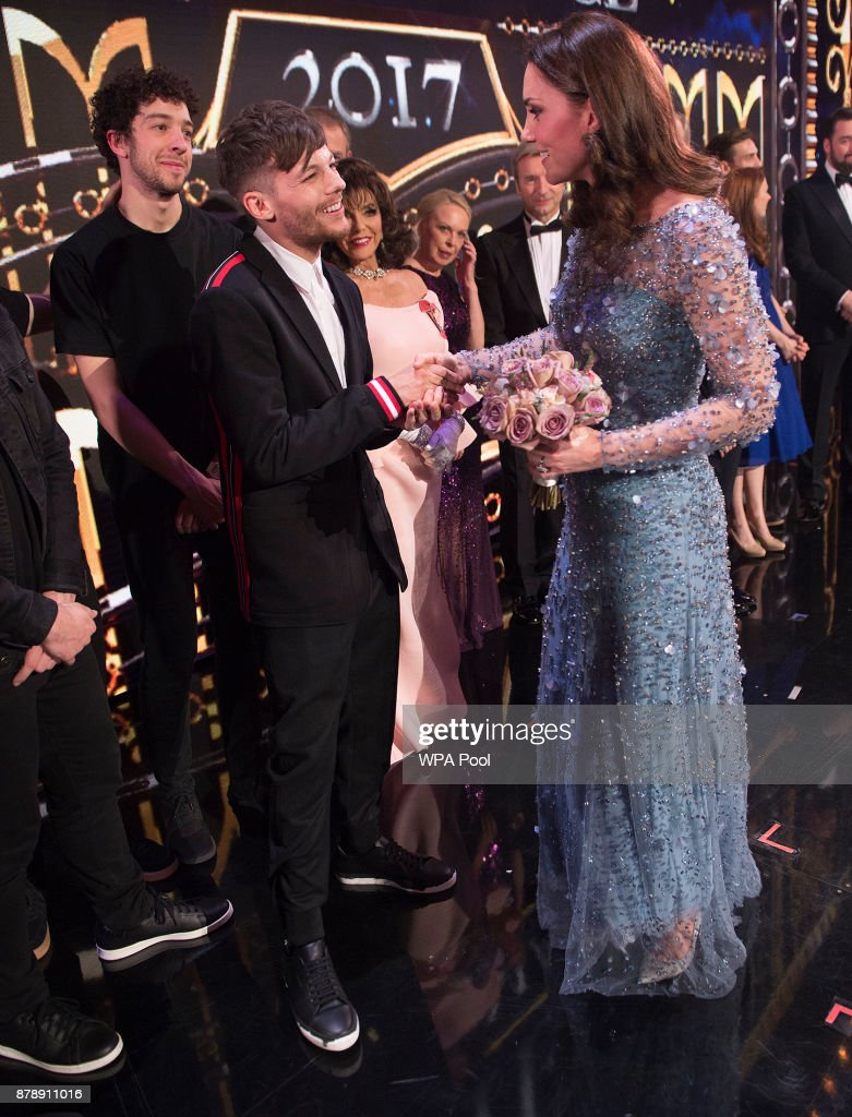 Catherine, Duchess of Cambridge speaks to Louis Tomlinson on stage as they attend the Royal Variety Performance at the Palladium Theatre on November November 24, 2017 in London, England. The Royal Variety Performance takes place every year, either in London or in a theatre around the United Kingdom. The event is in aid of the Royal Variety Charity, formally, The Entertainment Artistes Benevolent Fund, of which The Queen is Patron. The money raised from the show helps hundreds of entertainers throughout the UK, who need help and assistance as a result of old age, ill-health, or hard times.