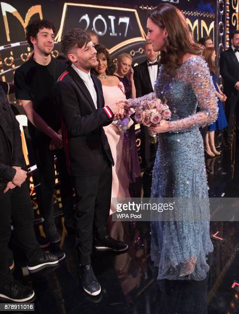 Catherine Duchess of Cambridge speaks to Louis Tomlinson on stage as they attend the Royal Variety Performance at the Palladium Theatre on November...