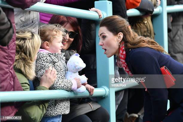 Catherine, Duchess of Cambridge speaks to members of the crowd as she leaves the RNLI Mumbles Lifeboat Station on February 04, 2020 near Swansea,...
