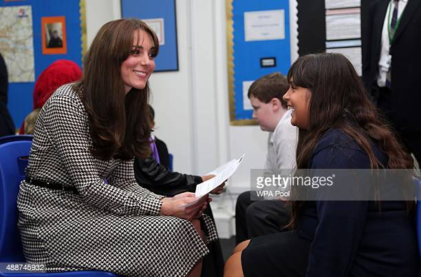 Catherine Duchess of Cambridge speaks to Mia about her classes during a visit to the Anna Freud Centre on September 17 2015 in London England The...
