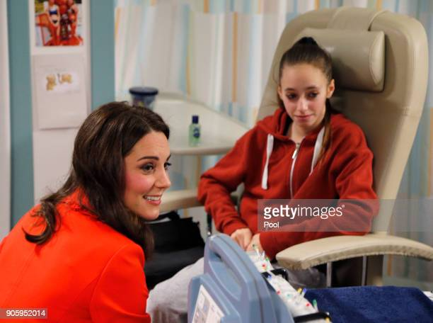 Catherine Duchess of Cambridge speaks to patient Gabriella Cook as she visits Great Ormond Street Hospital to officially open the Mittal Children's...