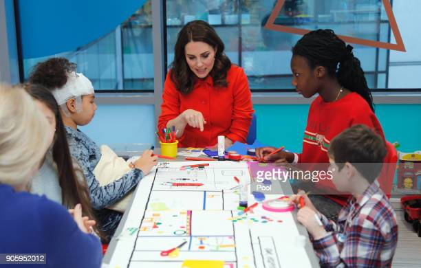 Catherine Duchess of Cambridge speaks to patients as she visits Great Ormond Street Hospital to officially open the Mittal Children's Medical Centre...