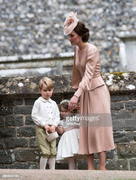 Catherine Duchess of Cambridge speaks to Princess Charlotte and Prince George after the wedding of Pippa Middleton and James Matthews at St Mark's...