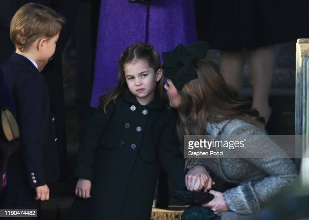 Catherine Duchess of Cambridge speaks to Princess Charlotte as Prince George watches as they leave after attending the Christmas Day Church service...
