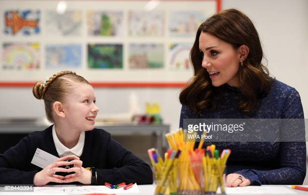 Catherine Duchess of Cambridge speaks to pupils from Albion Primary School as she officially opens the new headquarters of children's mental health...