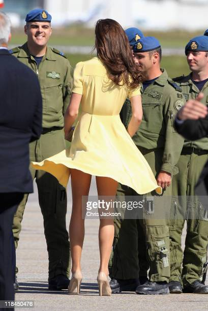 Catherine, Duchess of Cambridge speaks to soldiers as she arrives at Calgary Airport on July 7, 2011 in Calgary, Canada. The newly married Royal...